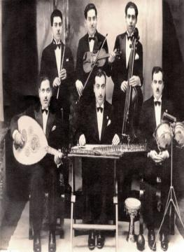 Iraq, 1938. Salah El Kuweiti standing second from the right. Taken from http://www.babylonjewry.org.il/